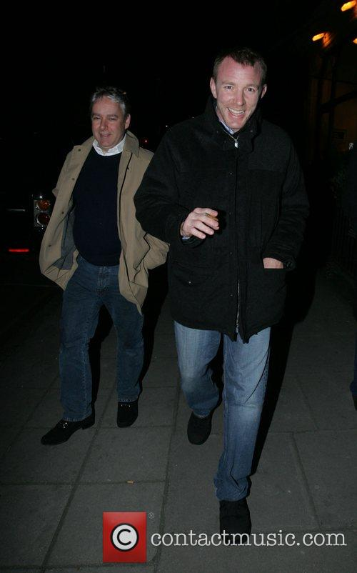 Guy Richie walking the streets of Mayfair