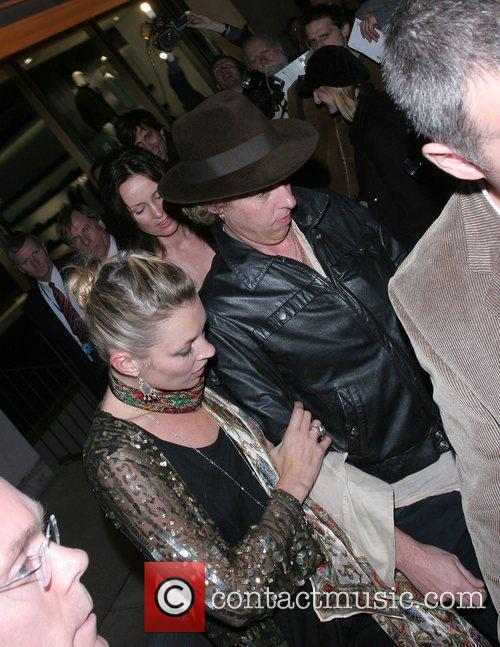 Kate Moss and James Brown attend the Linda...
