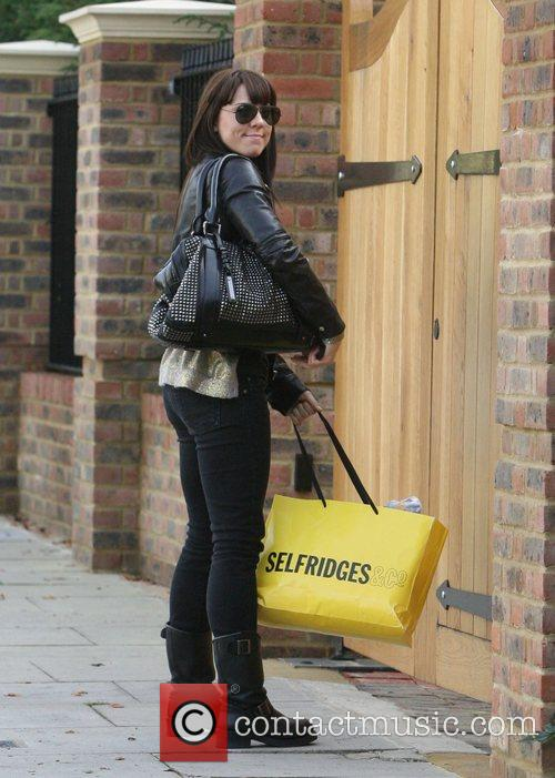 Arrives at Geri Halliwell's home for discussions about...