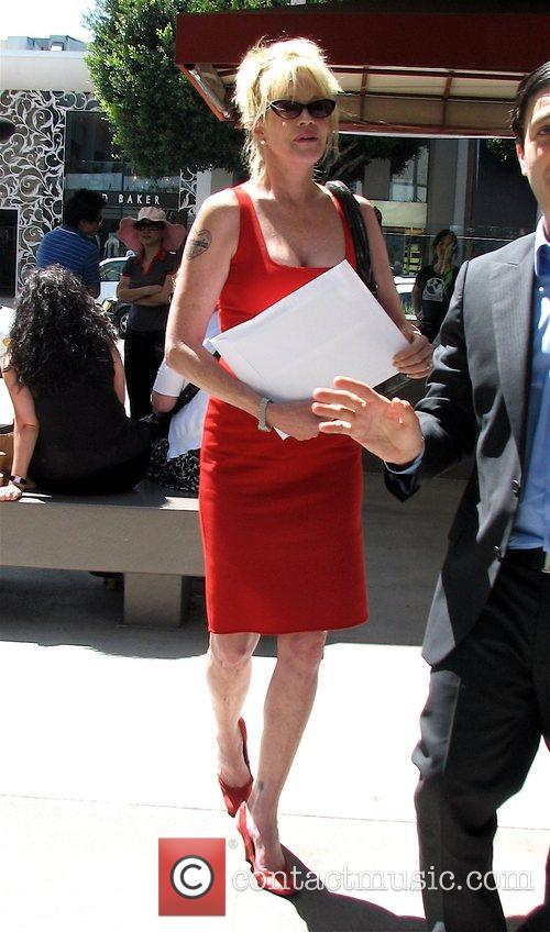 Melanie Griffith wearing a stunning red summer dress...