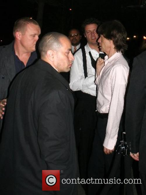 Mick Jagger surrounded by security 'Poiret: King of...