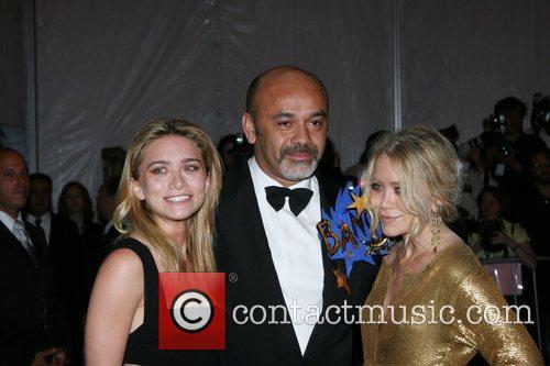 Ashley Olsen, designer Christian Louboutin and Mary-Kate Olsen...