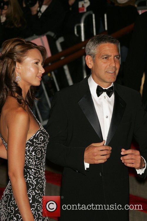George Clooney and Sarah Larson  'Superheroes: Fashion...