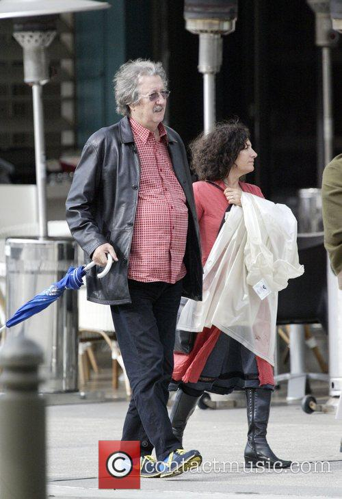 Out and about with his wife. The couple...