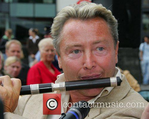 Dancer Michael Flatley plays the flute as he...