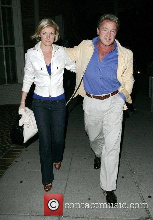 Leaving Mr Chow restaurant with his partner.