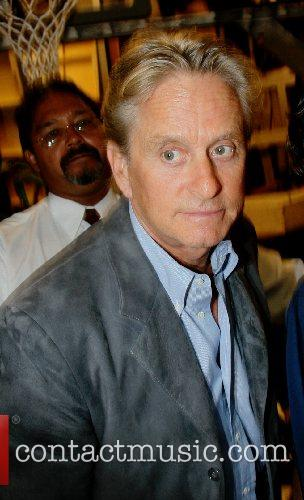 Michael Douglas signs autographs while leaving ABC Studios...