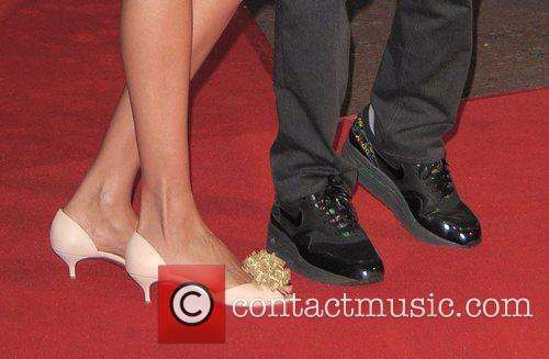 Mick Jagger wears wedge heeled trainers in an...