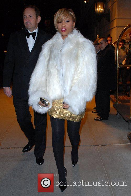 Eve leaving her hotel in a white fur...