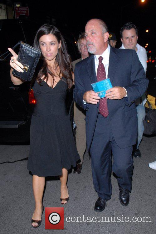 Billy Joel and guest out and about in...
