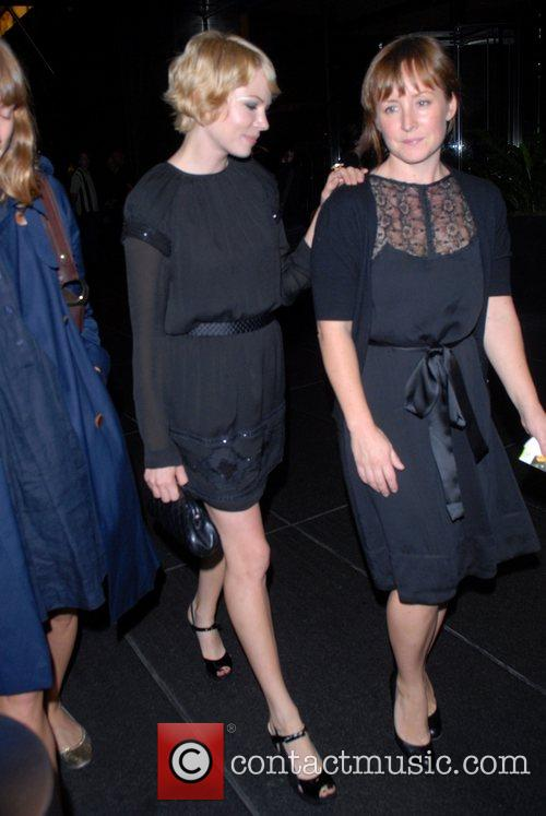 Michelle Williams and guest out and about in...