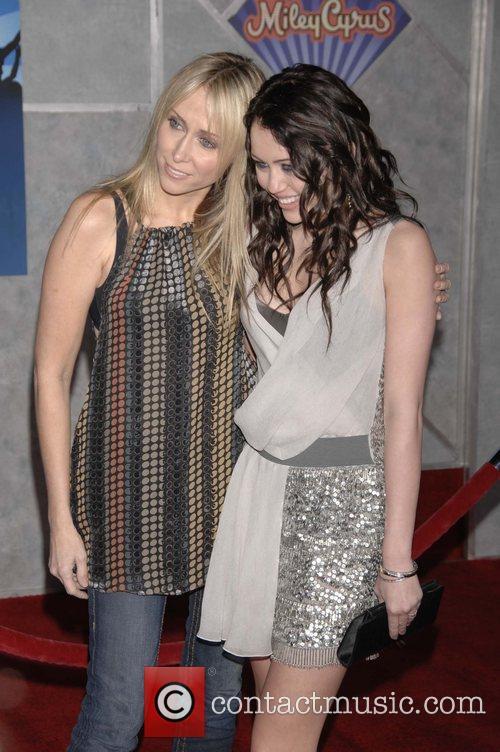 Miley Cyrus and Guest Film premiere Walt Disney...