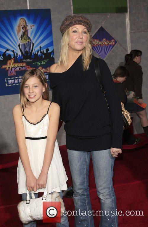 Heather Locklear and Guest Film premiere Walt Disney...