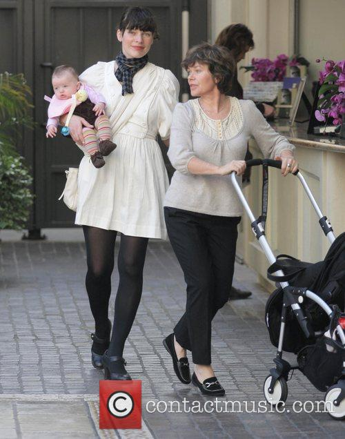 Milla Jovovich, her baby and mother stroll through...