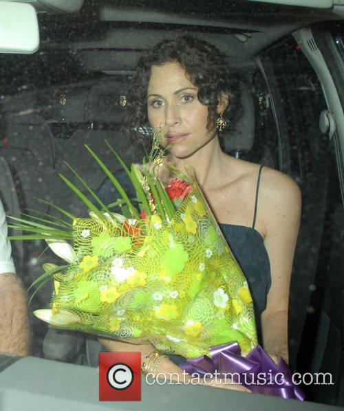 Minnie Driver with a bouquet of flowers leaving...