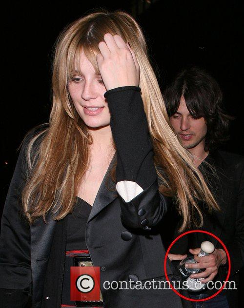 Mischa Barton, Her Boyfriend Taylor Locke, Who Is Clutching A Huge Bottle Of Tequila, Arrive Back At Their Hotel. Mischa Was In A Bad Mood, Covered Her Face To Try and Avoid Being Photographed. 7