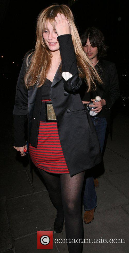 Mischa Barton, Her Boyfriend Taylor Locke, Who Is Clutching A Huge Bottle Of Tequila, Arrive Back At Their Hotel. Mischa Was In A Bad Mood, Covered Her Face To Try and Avoid Being Photographed. 8