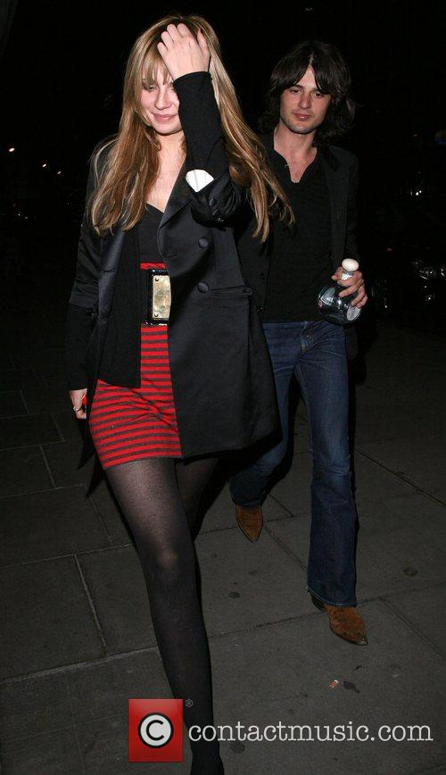 Mischa Barton, Her Boyfriend Taylor Locke, Who Is Clutching A Huge Bottle Of Tequila, Arrive Back At Their Hotel. Mischa Was In A Bad Mood, Covered Her Face To Try and Avoid Being Photographed. 3