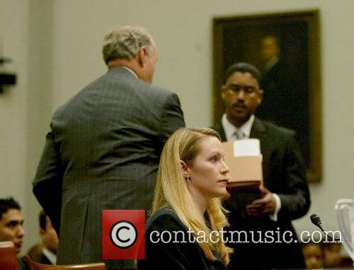 Monica Goodling in court with attorney Jeffrey M...