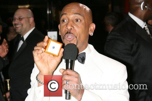 Montel Williams, Holding Blue Topaz The Montel Williams...