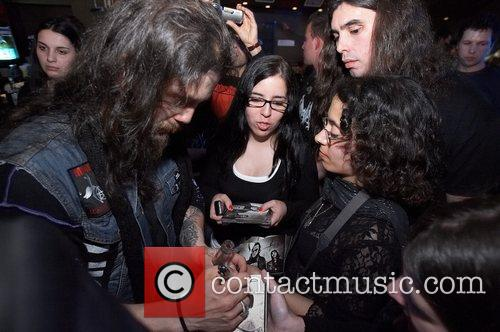 Mike Gaspar drummer of band Moonspell giving autographs...