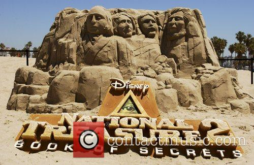 Giant sand sculpture of american memorial Mount Rushmore...