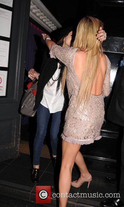 Danielle Lloyd greeting a friend when arriving at...