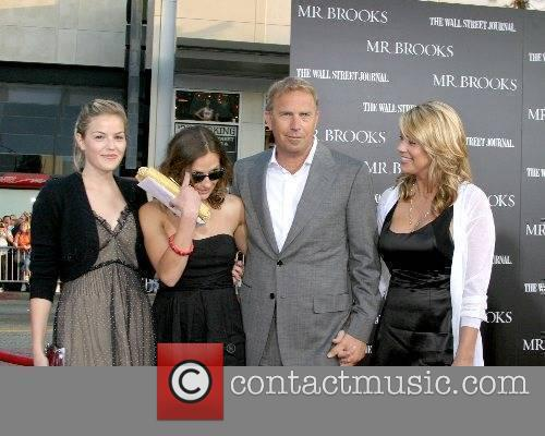 Kevin Costner and Christine Costner and his daughters...