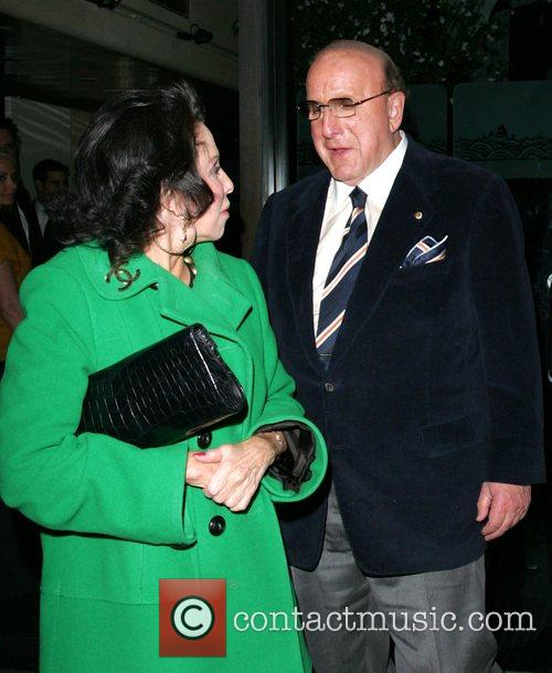 Clive Davis and a female companion leaving Mr.Chow