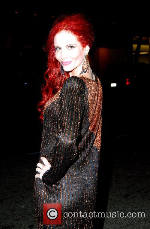 Phoebe Price posing for photographers outside Mr Chow...