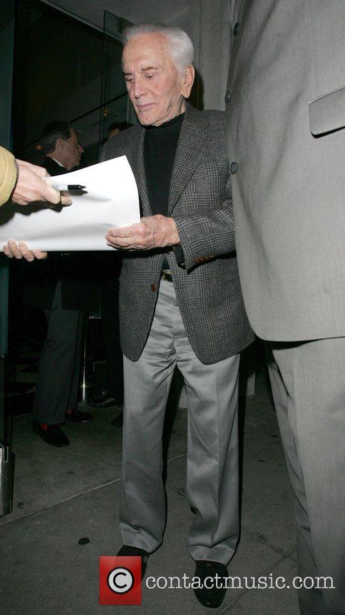Kirk Douglas signing autographs outside Mr Chow restaurant...