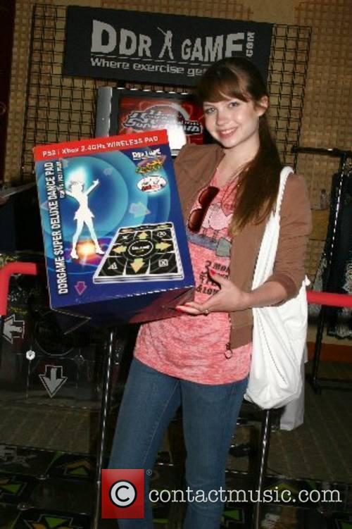 Daveigh Chase poses with the popular dancing arcade...
