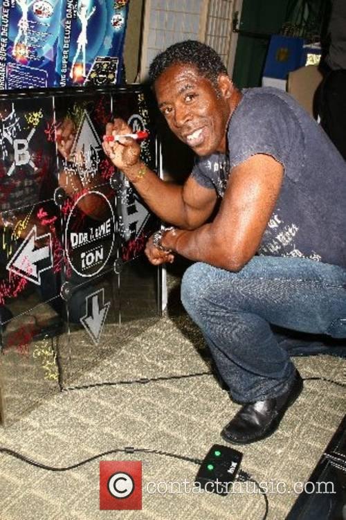 Ernie Hudson autographs the popular dancing arcade game,...