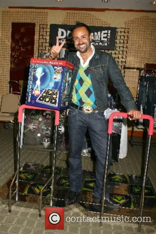 Nick Verreos poses with the popular dancing arcade...
