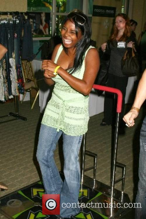 Shar Jackson tries the popular dancing arcade game,...