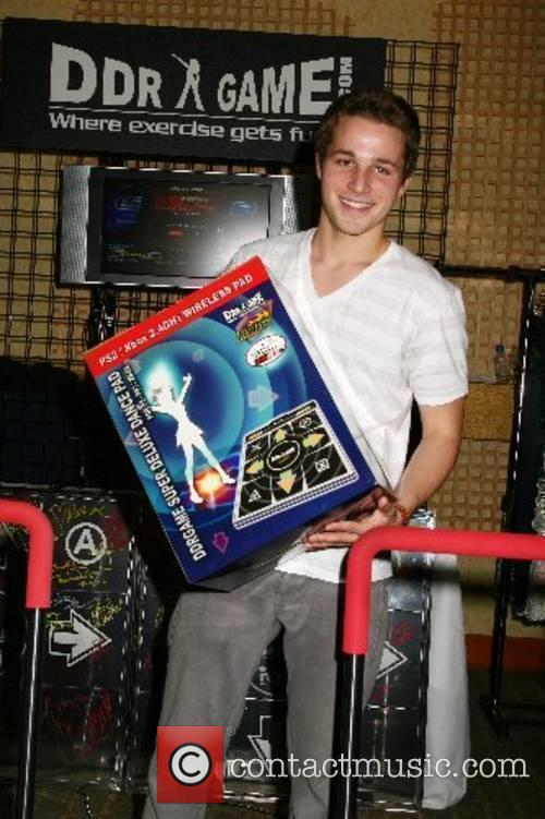 Shawn Pyfrom poses with the popular dancing arcade...