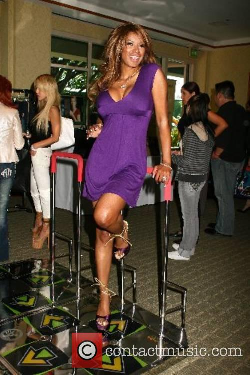 Traci Bingham poses with the popular dancing arcade...