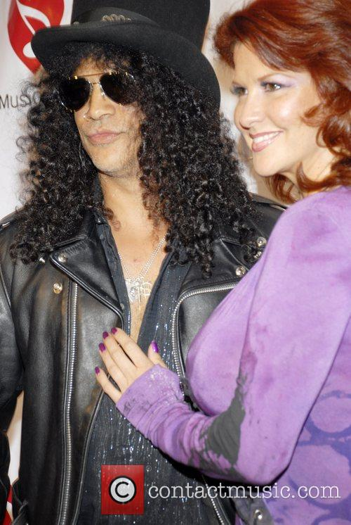 Slash and his wife The 4th Annual MusiCares...