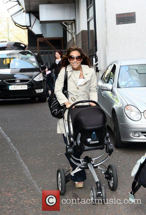 Leaving the GMTV studios with her baby daughter...
