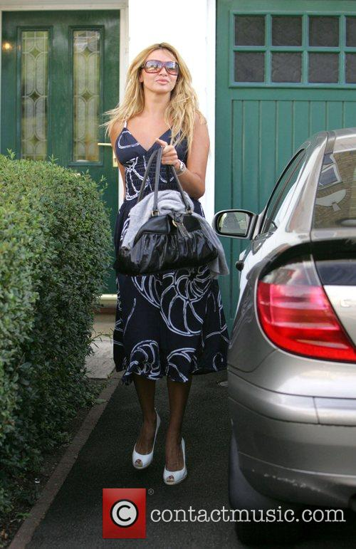 Nadine Coyle leaves her house this morning and...