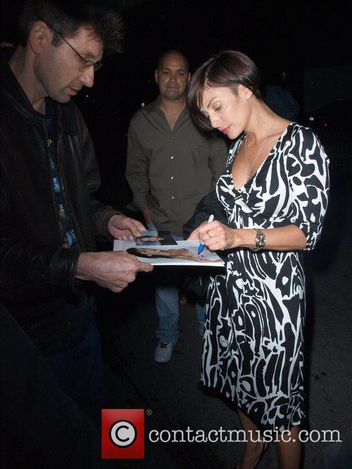 Natalie Imbruglia signs autographs as she leaves Villa...