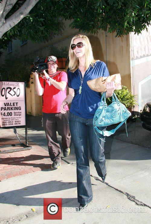 Natasha Henstridge out walking in West Hollywood carrying...
