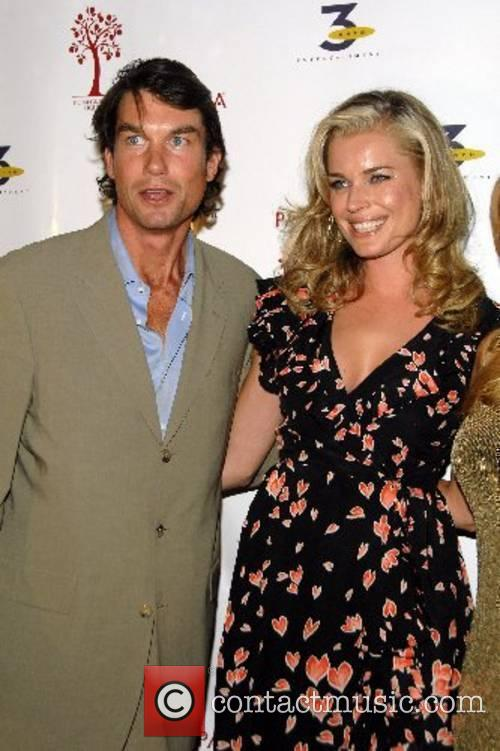 Rebecca Romijn and Jerry O'Connell celebrating the Network...
