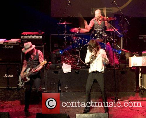 The New York Dolls performing in concert at...