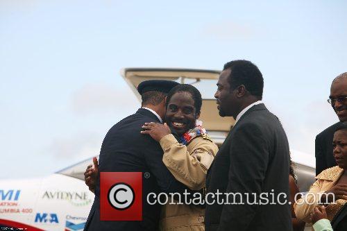 Barrington Irving, 23, hugs his mentor Capt. Gary...