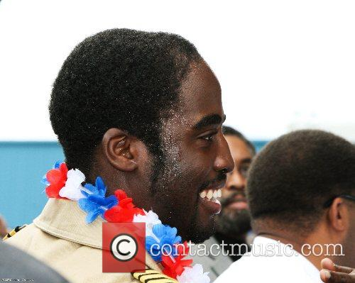 Barrington Irving, 23, greets well-wishers after landing his...