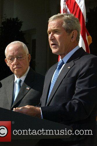 Judge Michael Mukasey and President George W Bush...