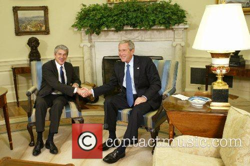 US President George W Bush welcomes Prime Minister...