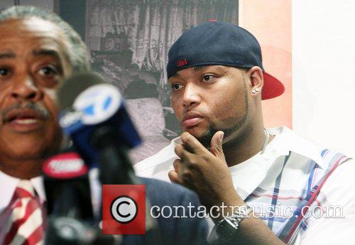 Joseph Guzman at a press conference where Rev....