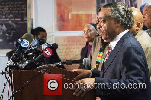 Rev. Al Sharpton speaking at a press conference...